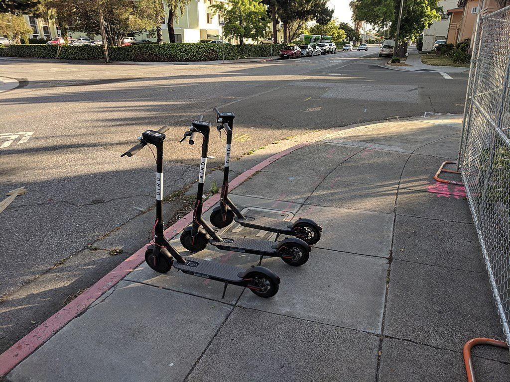 Photo of three bird scooters on the sidewalk in San Jose, CA