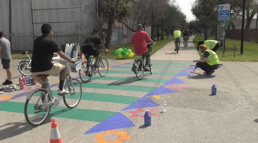 Photo of community members biking into the Harrisburg Hike and Bike Trail on the pop-up bike lane