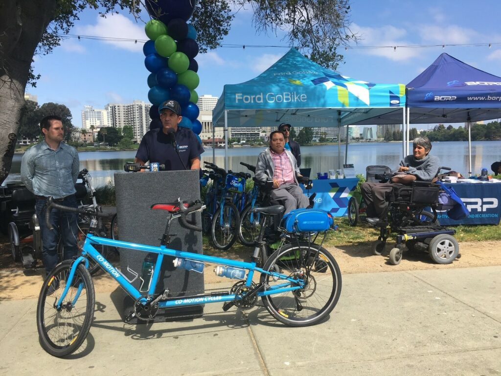 Shows launch of Oakland adaptive bikeshare, with some of the vehicles