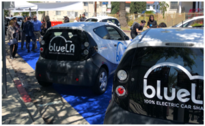 A picture of two electric vehicle carshare cars that are part of LA's BlueLA EV Carshare pilot.