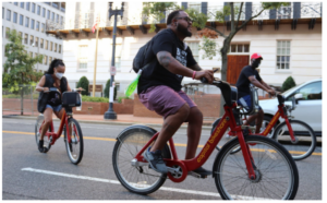 A picture of three people riding Capital Bikeshare bikes in Washington, DC.