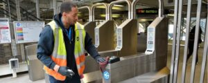 Photo of Chicago Transit Authority employee cleaning turnstiles