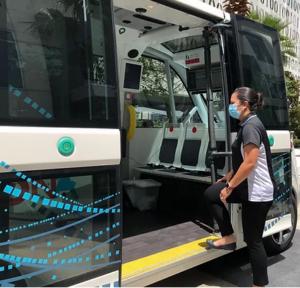 Man entering shuttle wearing a mask