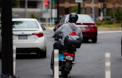 Image of person using moped