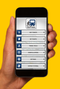 A picture of a person holding a smartphone with DART's GoPass app on it.