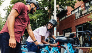Man and woman unlock Divvy bikes