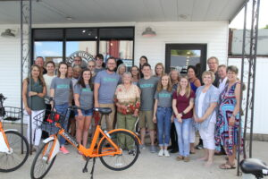 Pocahontas bikeshare team surrounds bike