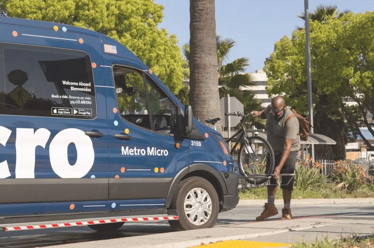 Image of customer mounting bicycle onto LA Metro Micro vehicle