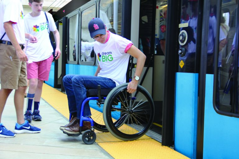 Image of person in wheelchair exiting light rail car