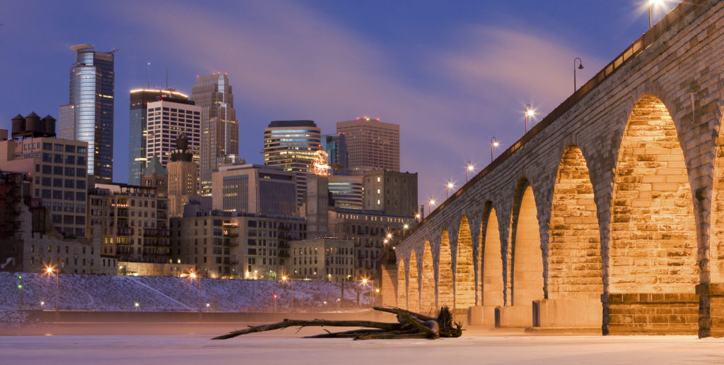 Photo of the Mississippi River and Minneapolis skyline in the background