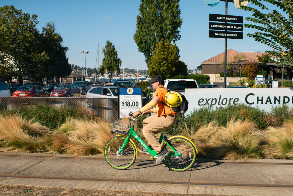 Photo of someone riding a bikeshare bike