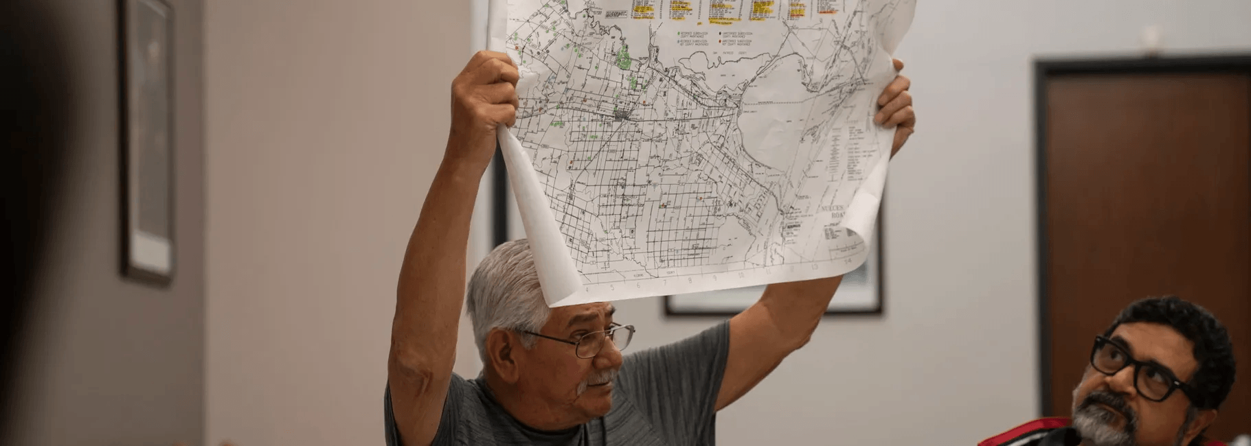 Man holding a map in the area.