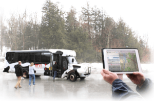 Trip Planner tool displayed on tablet in front of VT Moover bus