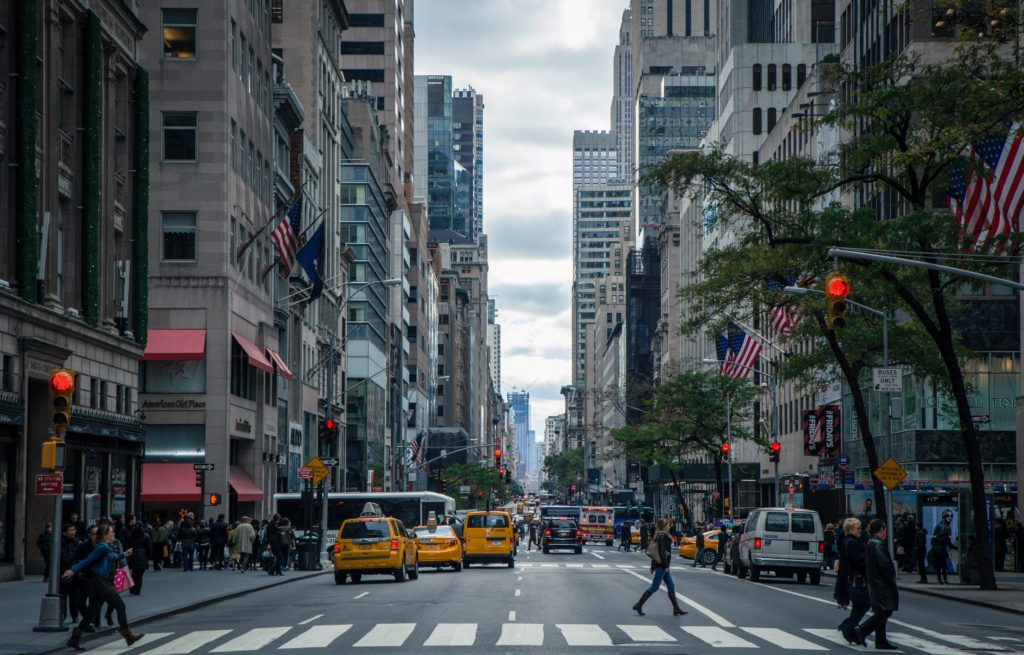 Photo of New York City Street with taxis and people walking