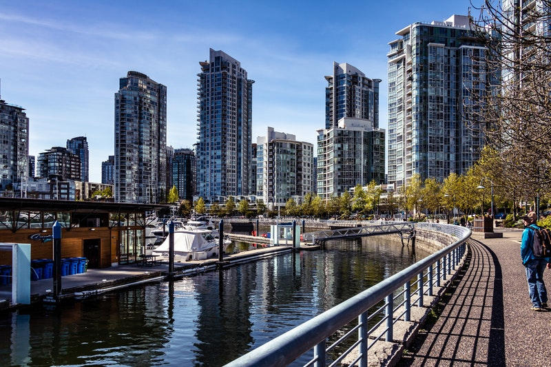 Waterfront walkway in Vancouver leading to new midrise and highrise developments