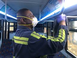 Rabbittransit employee sanitizes vehicle in mask and gloves during COVID outbreak